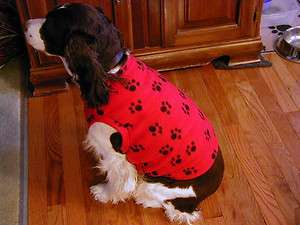 BLACK PAWS ON RED fleece dog sweater vest