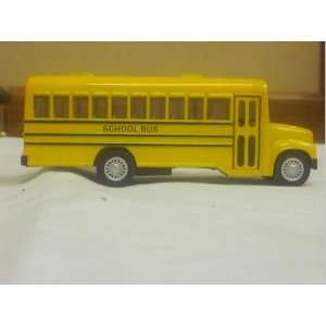 Yellow Toy School Bus with Stop Sign on Side and It Says School Bus