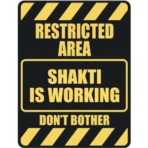 RESTRICTED AREA SHAKTI IS WORKING  PARKING SIGN