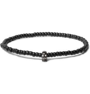 Jewellery  Bracelets  Mini Black Gold Skull Bracelet