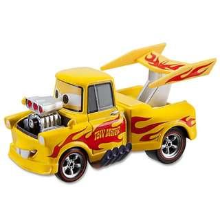 NIB Disney Pixar Cars 2 Drag Star Mater Cars 2 Die Cast Car in plastic