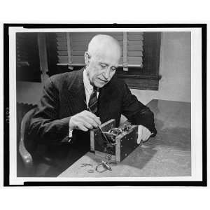 Orville Wright,1871 1948,working on small machine,gears