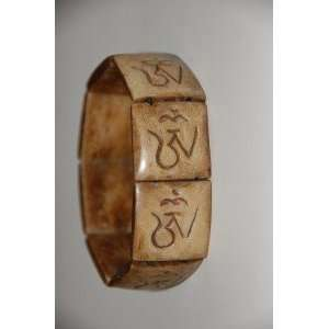 Carved Yak Bone Bracelet with Om Script From Nepal