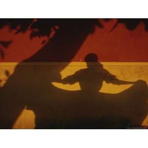 The Shadows of a Tree and Dancing Woman on a Brightly Painted Wall