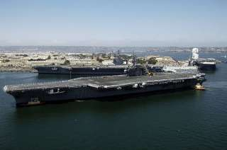 FileUSS Kitty Hawk (CV 63) steams past USS George Washington (CVN 73